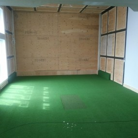 Golf room prepped for wall panels