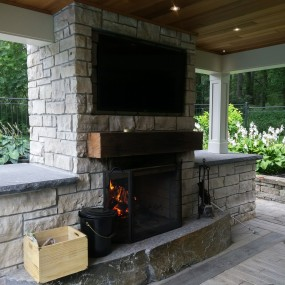 Outdoor fireplace in pergola